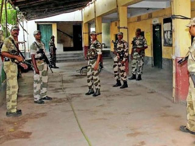 Central force jawans stand guard inside a polling booth in West Bengal in April.