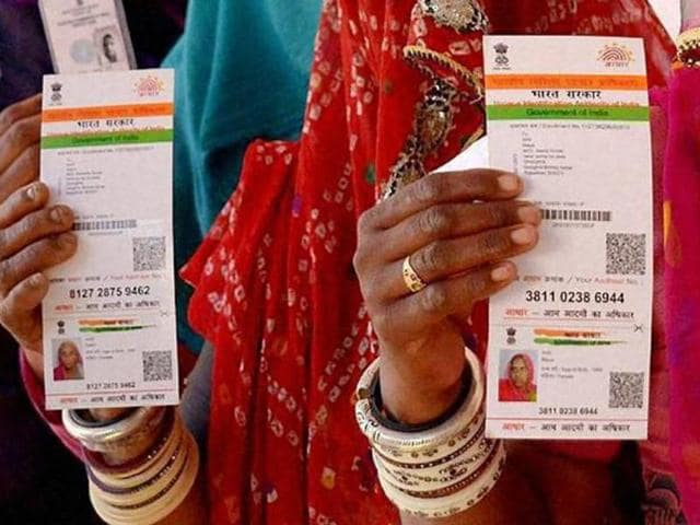 Ajmer: Rajasthani women showing their respective Aadhaar cards while standing in a queue to vote for Ajmer District Panchayat elections on Friday. PTI Photo (PTI1_22_2016_000271B)