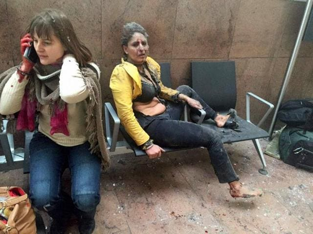 File photo provided by Georgian Public Broadcaster and photographed by Ketevan Kardava shows Nidhi Chaphekar, right, a 40-year-old Jet Airways flight attendant from Mumbai, and another unidentified woman after being wounded in Brussels Airport in Brussels, Belgium, after explosions were heard on March 22, 2016.