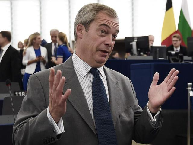 Vice President of the European Commission Frans Timmermans (R) speaks with former leader of the United Kingdom Independence Party (UKIP) Nigel Farage at the European Parliament in Strasbourg, eastern France, on Wednesday.