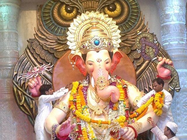 Devotees surround Lalbaugcha Raja idol of Hindu god Ganesha on the last day of Ganesha Chaturthi festival in Lalbaug area Mumbai on Thursday.