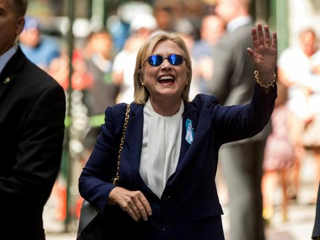 Democratic presidential candidate Hillary Clinton waves after leaving an apartment building in New York on Sept 11, 2016. Hillary Clinton's doctor says she is recovering from her pneumonia and remains