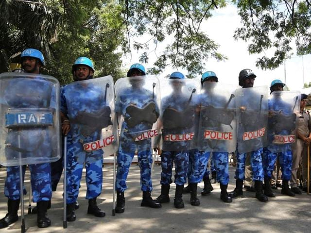 Riot police stand guard to prevent pro-Karnataka activists from entering a train station to stop trains in a protest against the SC ruling on Cauvery river dispute, in Bengaluru.