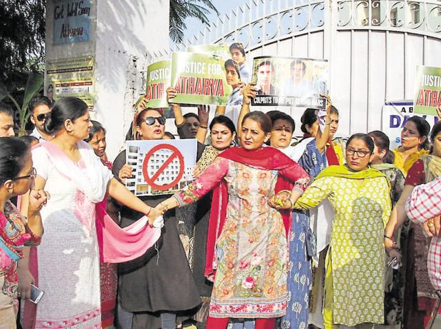 Parents of DAV School students protesting outside the school premises on Pakhowal Road on Wednesday.