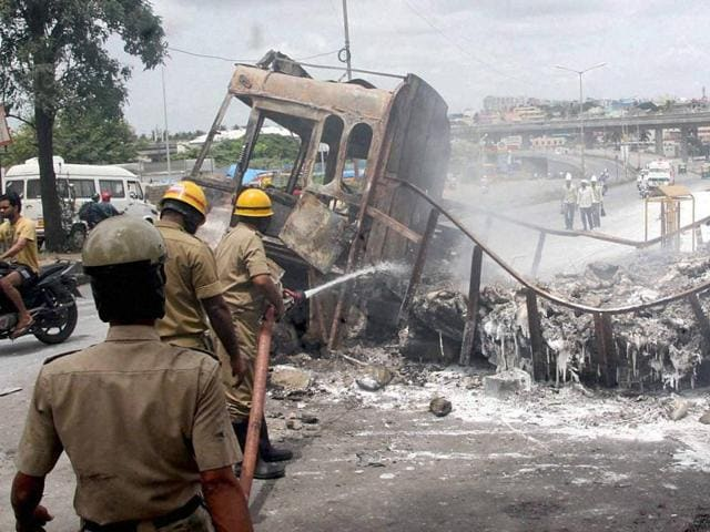 Protesters vandalise hoardings of Tamil superstar Rajinikanth during a protest over the Cauvery water row, in Mysore on September 12.