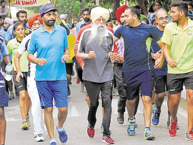 Marathon runner Fauja Singh during the 'Run for Health' event at Punjabi University in Patiala on Wednesday.