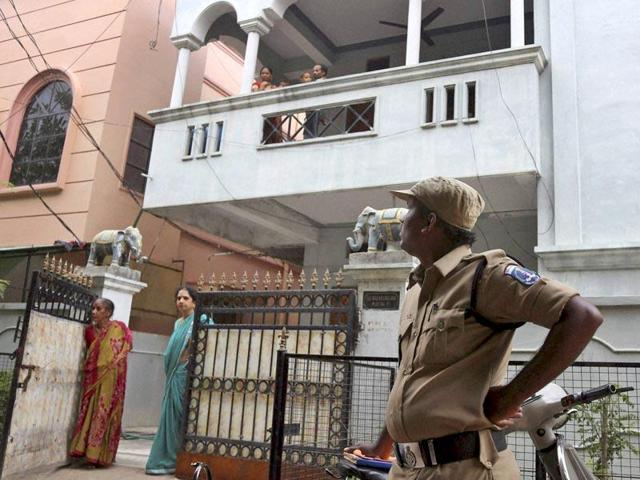 A policeman stands outside the residence of one of the four Indian nationals detained near the Libyan city of Sirte, in Hyderabad.