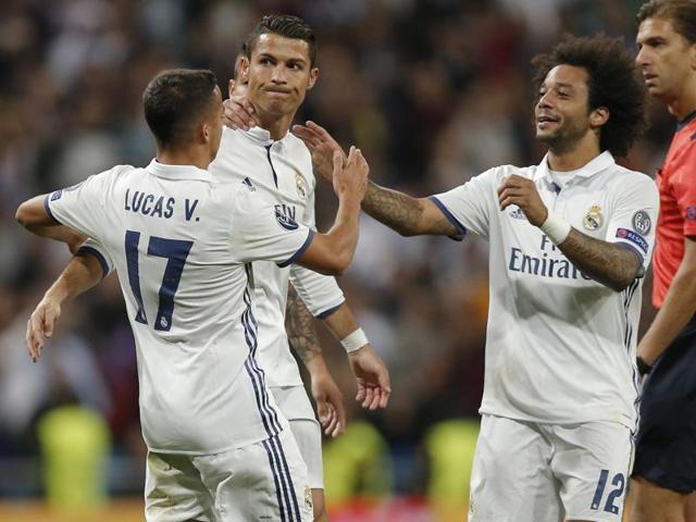 Real Madrid's Cristiano Ronaldo celebrates goal with team mate James Rodriguez.