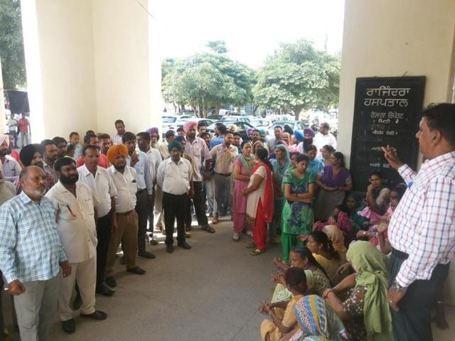 Protesting Class 4 employees raising slogans outside Rajindra Hospital in Patiala on Friday