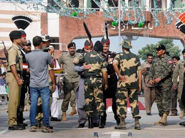 Personnel of the Pakistani Rangers and Border Security Force at the Attari-Wagah check post in August. On Thursday, the mortal remains of 160 Pakistani Hindus who died in the past one decade were brought to India through the check post.