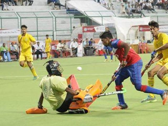 MP hockey academy goalkeeper tries to save a goal during their match against CAG on Thursday.