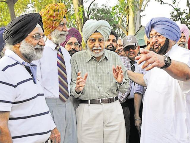 Punjab Congress president Capt Amarinder Singh with ex-servicemen during a march to Raj Bhawan in Chandigarh on Thursday.