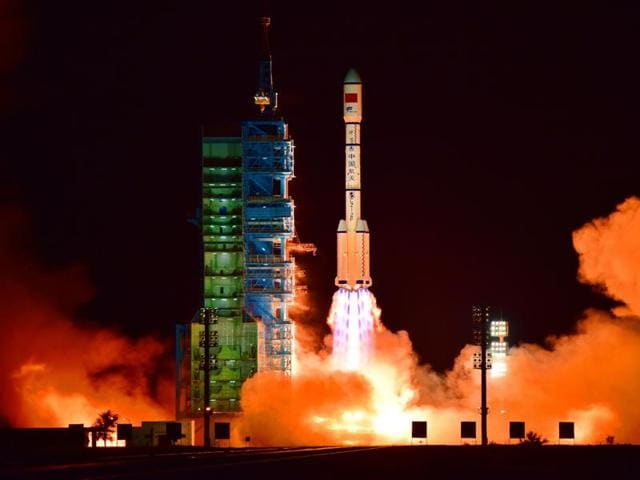 The Shenzhou 11 capsule will be propelled by a Long March 2F rocket similar to the one which put the experimental space lab Tiangong-2 (pictured) into orbit without a hitch on Thursday .