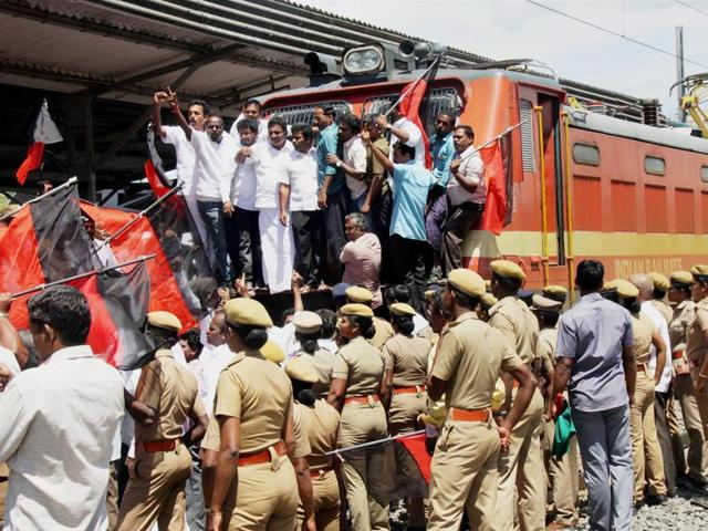 DMK members stage a rail roko in the Coimbatore railway station on Friday.