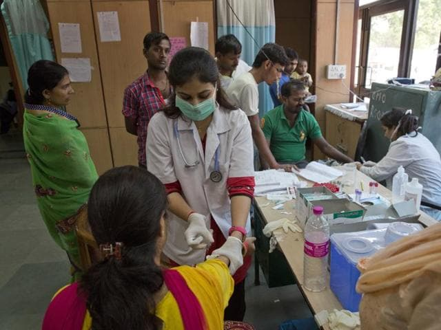 A doctor administers an injection to a woman at a fever clinic especially set up to cater to those suffering from fever, one of the main symptoms of several mosquito-borne diseases, at Ram Manohar Lohia hospital in New Delhi.