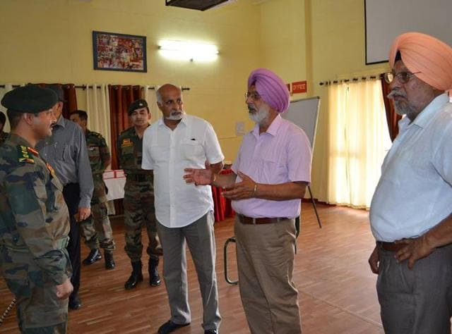 (From right) Brigadier Inderjeet Gakhal, Colonels Shivdev Mann and Vijay Sandhu interacting with troops of 4 Mech at Jaisalmer during their mission to apprise men of their old battalion of the challenges of serving in a high-altitude area.
