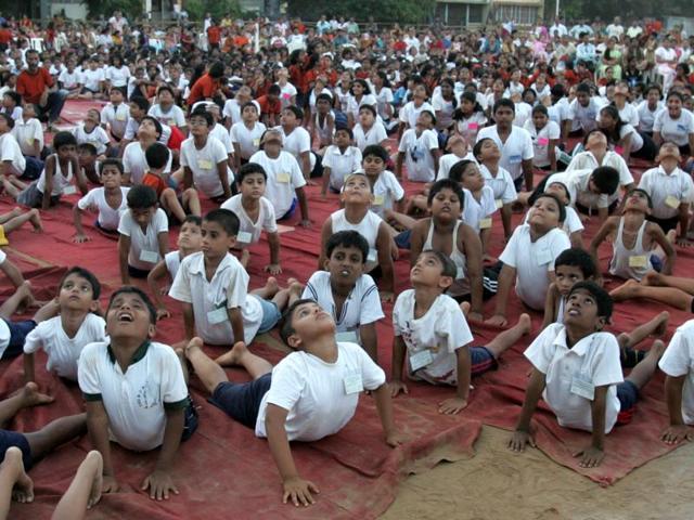 Students perofrming Surya Namaskar at an event in Mumbai.