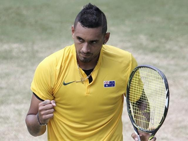 Australia's Nick Kyrgios hits a return against Slovakia's Andrej Martin in their men's singles tennis match.
