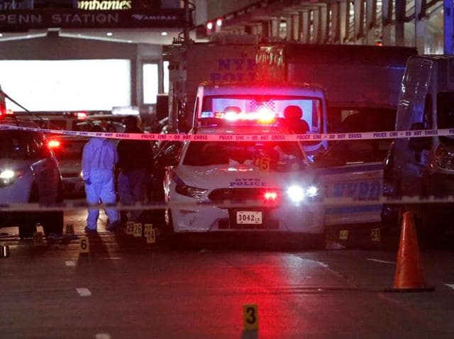 Police investigate the scene where a man was shot by police in Manhattan, New York.