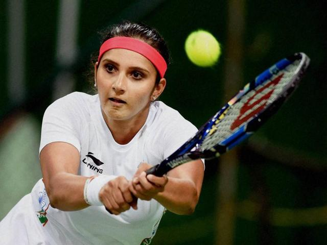 India's Sania Mirza in action during her mixed doubles match along with partner Rohan Bopanna.