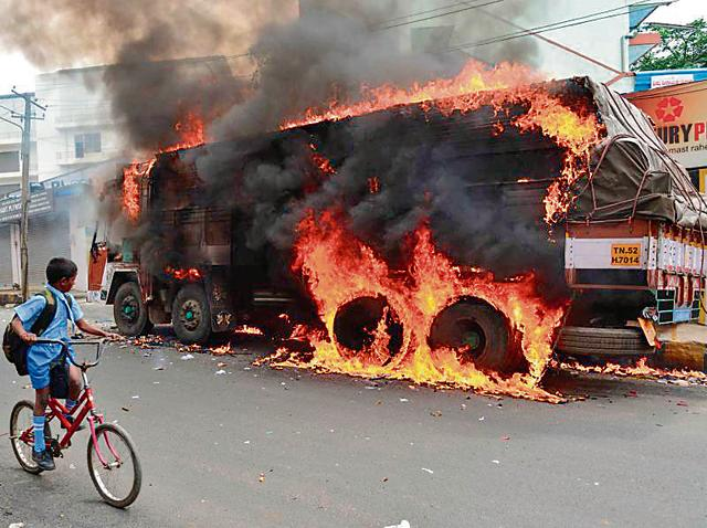 Bengaluru : Charred remains of the vehicles torched by pro-Kannada activists during a protest over Cauvery water distribution, Bengaluru, September 13