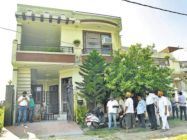 Residents gathered in front of the house where a private company is installing mobile tower at Tower Enclave in Jalandhar.