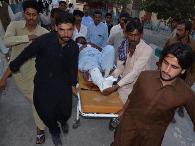 People rush an injured person to a hospital following a bomb blast, in Quetta, Pakistan, Tuesday, Sept. 13,2016.