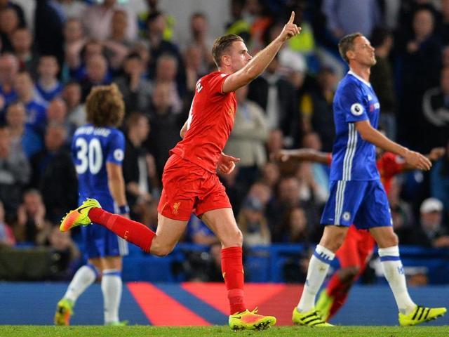 Liverpool's Jordan Henderson (C) celebrates with Dejan Lovren (R) after scoring his team's second goal.