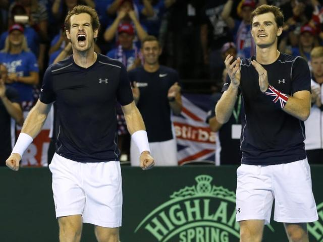 Andy Murray and Jamie Murray shake hands with Juan Martin del Potro and Leonardo Mayer after winning their doubles match.