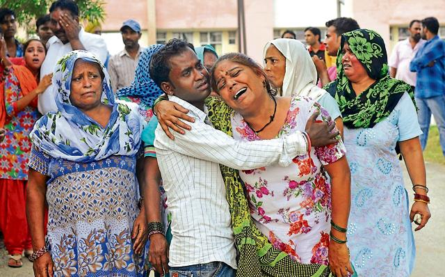 Grieving relatives of the deceased at the civil hospital in Ludhiana on Friday.
