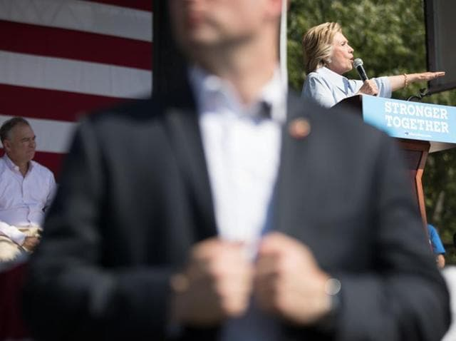 A member of the Secret Service stands guard as Democratic presidential candidate Hillary Clinton, right, speaks in Cleveland, Ohio.