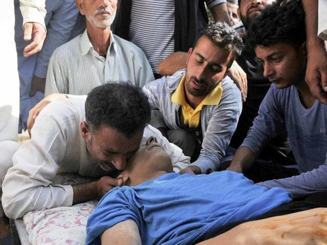 Father of a 10-year-old Nasir Shafi Qazi cries during a funeral procession on the outskirts of Srinagar on Saturday. The Family has alleged he was shot with pellets by security forces during clashes in the area earlier .