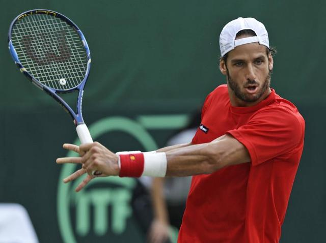 Spain's Feliciano Lopez plays a shot in his Davis Cup men's tie against India's Ramkumar Ramanathan.
