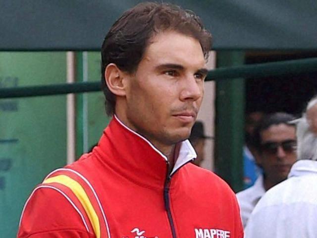 Spain's Rafael Nadal watches a Davis Cup men's tie tennis match between David Ferrer and Saketh Myneni.