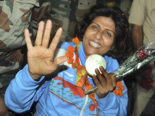 Colonel BK Nagpal, father of Deepa Malik, welcomes her at the New Delhi airport on Saturday. Malik credits her army upbringing for her strength and resolve.