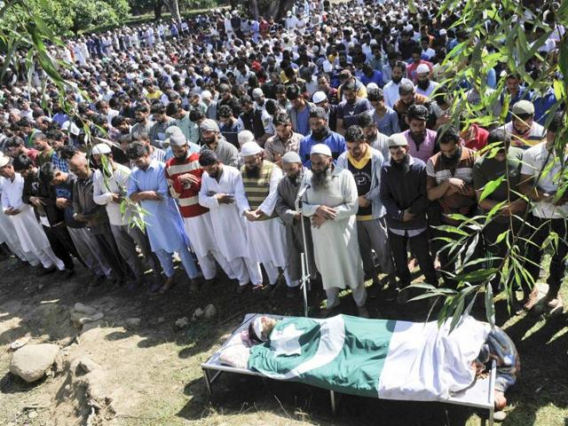Kashmiri people offer funeral prayers of 10-year-old Nasir Shafi Qazi during a funeral procession on the outskirts of Srinaga,  on Saturday, September 17,2016.