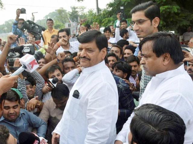 SP leader Shivpal Yadav, along with his son, Aditya Yadav, and Gayatri Prajapati, right, addresses supporters outside his residence in Lucknow.