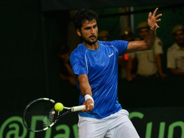 India's Saketh Myneni in action against Spanish tennis player David Ferrer during the Davis Cup.