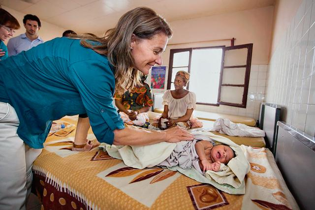 Melinda Gates visits a baby at the Marie Stopes International Outreach Program health post in Senegal, in July 2012.