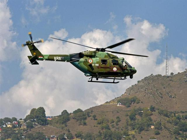 A chopper air-lifting injured soldiers after Army Brigade camp was attacked by militants in Uri.