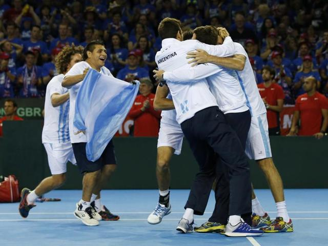 Argentina's Leonardo Mayer shakes hands with Great Britain's Dan Evans at the end of the match.