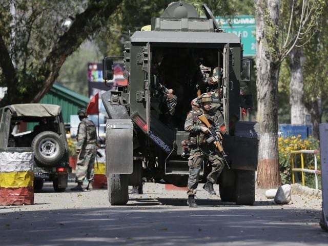 Army soldiers arrive at the military base which was attacked by militants in Jammu and Kashmir's Uri town.(AP Photo)