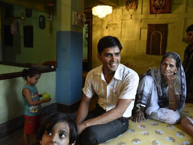 Kapil Gupt, a young man from the Gayawal Panda community, with his grandmother Chameli Devi at their house in Gaya.