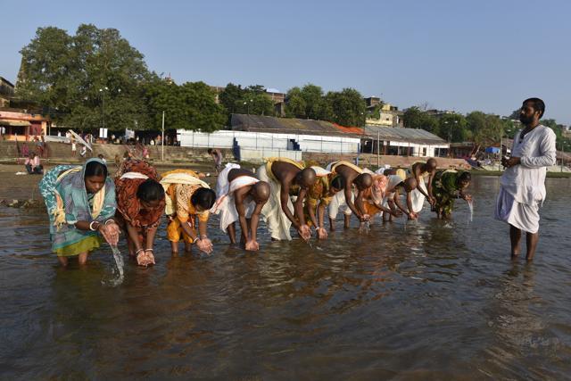 People perform tarpan in the Phalgu river during the pitrapaksha mela in Gaya