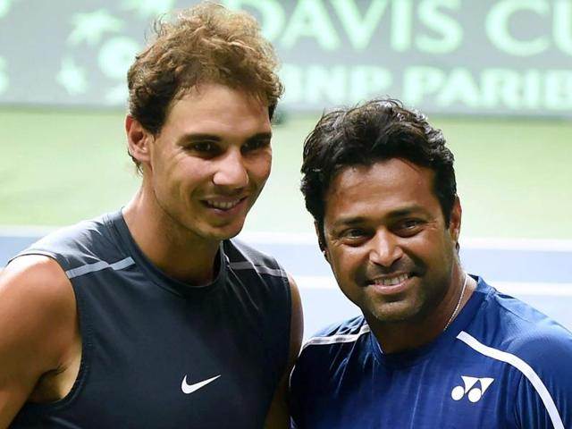 Spain's Rafael Nadal with India's Leander Paes poses for photographs during a practice session.)