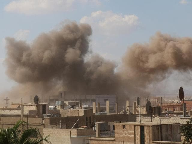 Smoke rises after an airstrike in the rebel-held town of Dael, in Deraa Governorate, Syria.