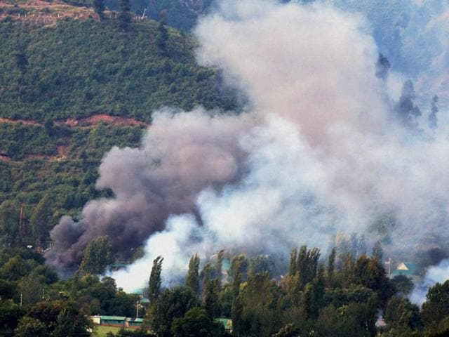 Smoke rises from an Indian Army Brigade camp during a terror attack in Uri, Jammu and Kashmir on Sunday.(PTI Photo)