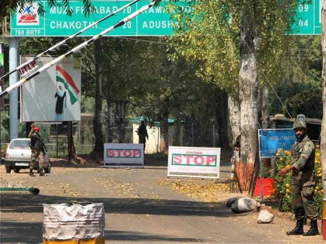 Soldiers guard the army base which was attacked by militants in Uri,  on Monday.