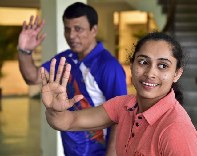 New Delhi: Dipa Karmakar (R), who missed out on an Olympic medal by 0.150 points in Vaults final, with coach Bishweshwar Nandi at IG Stadium in New Delhi on Saturday. PTI Photo by Kamal Kishore (PTI8_20_2016_000089A)
