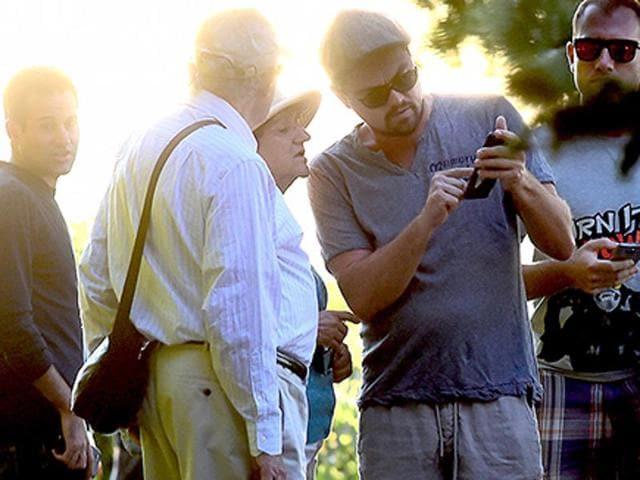 Leonardo DiCaprio helping the unsuspecting elderly couple.